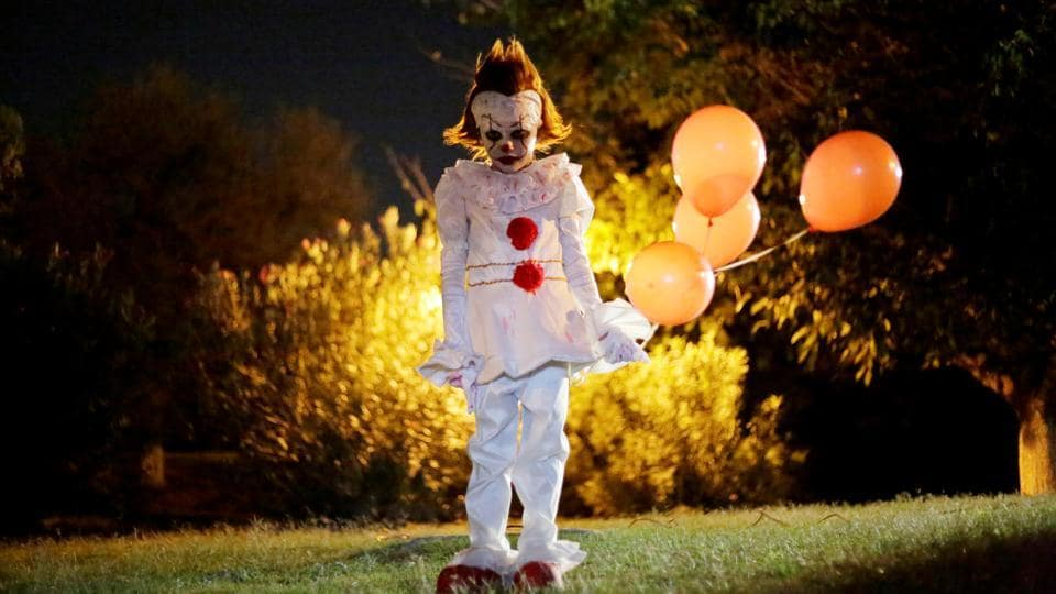 A child dressed as Pennywise, the dancing clown from the movie 'It' poses for a photo during a Halloween party in Ciudad Juarez, Mexico.  (Jose Luis Gonzalez / REUTERS)