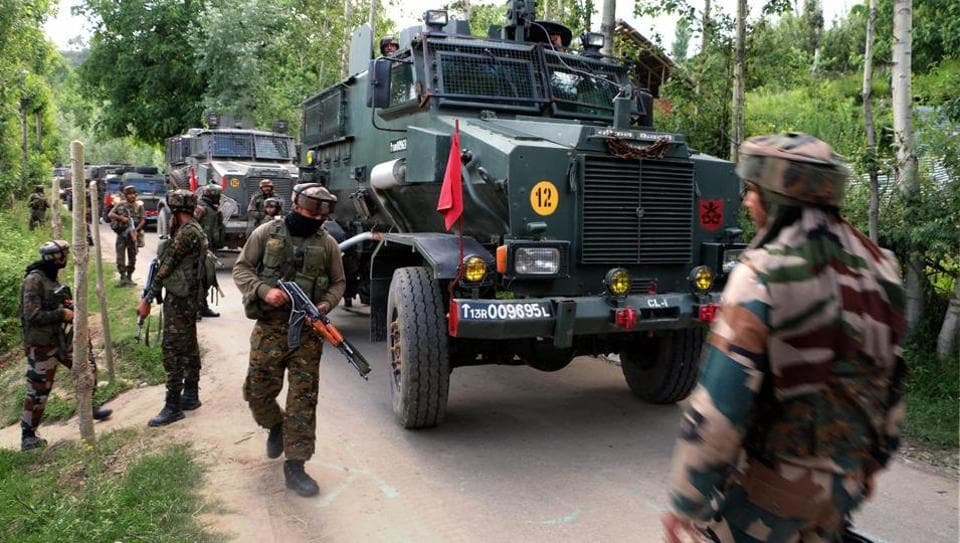 Army cordoning off an area near the house where militants were hiding during an encounter at Bamnoo in Pulwama district of south Kashmir.
