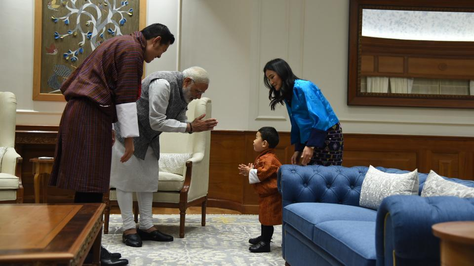 Bhutanese King Jigme Khesar Namgyel Wangchuck and Queen Jetsun Pema look on as Prime Minister, Narendra Modi interacts with their son, Prince Jigme Namgyel Wangchuck during a meeting in New Delhi on Wednesday. (PMO)
