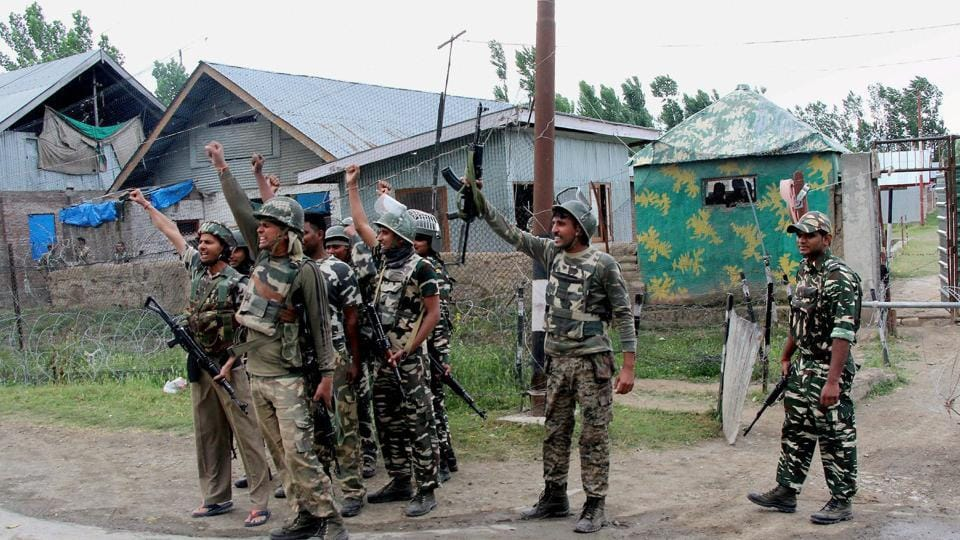 Security personnel celebrate after killing four militants who attacked a CRPF camp at Sumbal in Bandipora district of north Kashmir.