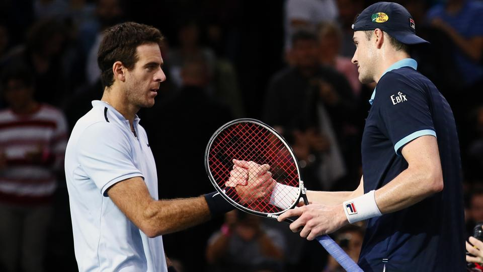 John Isner shakes hands after his victory over Juan Martin Del Potro during a quarter-final match of Paris Masters.