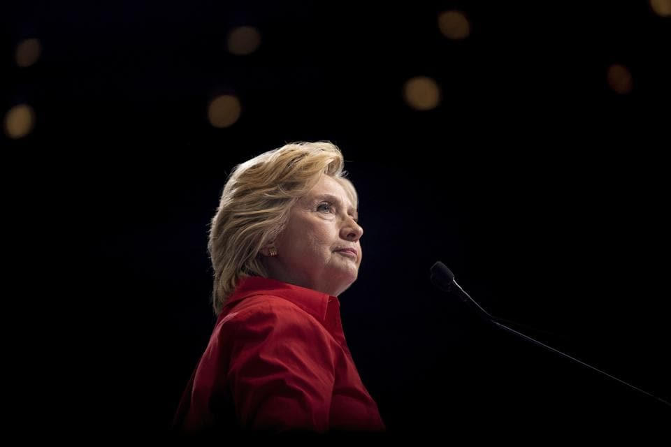 Hillary Clinton pauses while speaking at a rally in Pittsburgh during a bus tour through the rust belt.