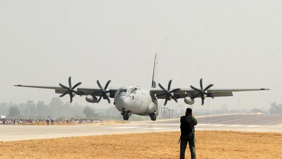 An Indian Air Force Hercules C-130J prepares to touch down at the Agra-Lucknow highway during an exercise by the Indian Air Force in Uttar Pradesh on October 24, 2017.