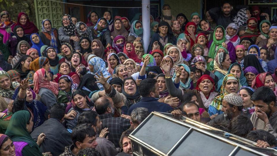 Relatives and neighbours of Gowhar Hussain Bhat, a BJP youth leader, carry his coffin during his funeral in Shopian, Kashmir on Friday. The body of 30-year-old Bhat was recovered from an orchard in Kiloora with his throat slit, and attributed to insurgents by the police. (Dar Yasin / AP)