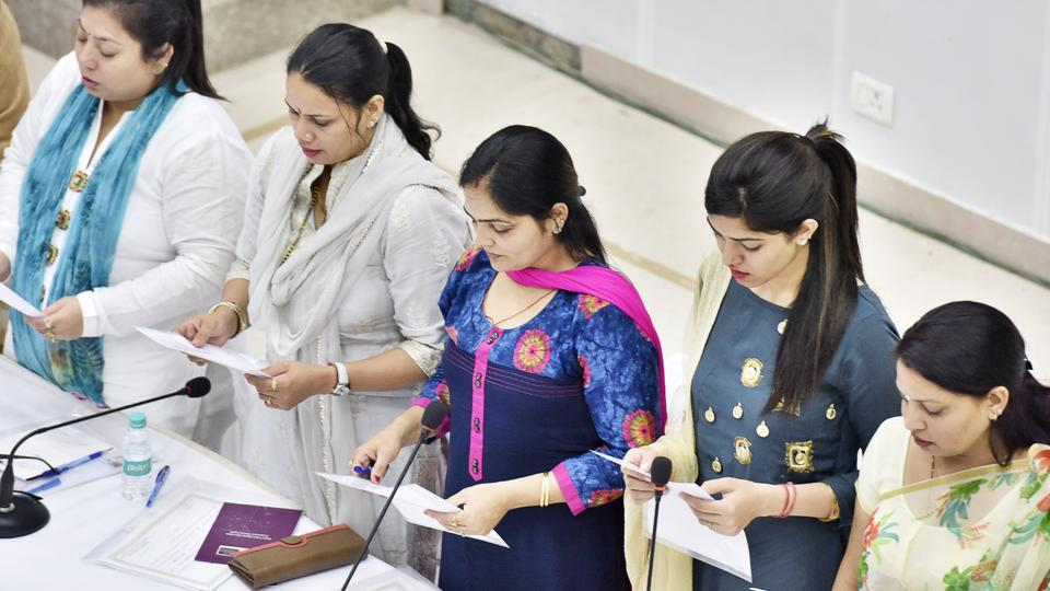 Newly elected councillors take the oath on Friday.