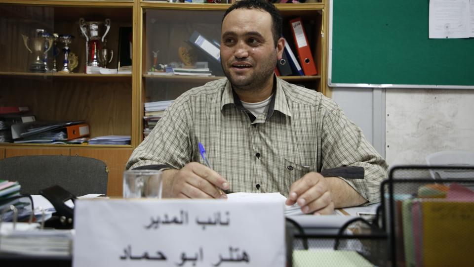 Palestinian Hitler Abu Hamad, deputy head at a school, sits at his office in the Israeli occupied city of Hebron, on September 26.