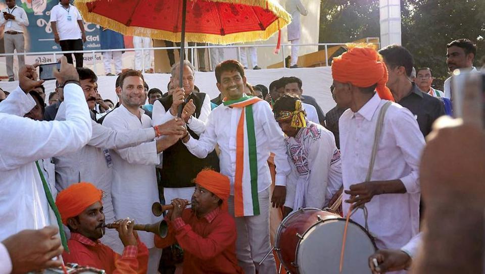 Congress vice president Rahul Gandhi with party leaders at the party's 'Navsarjan Janadesh Mahasammelan' in Gandhinagar, Gujarat on Monday.