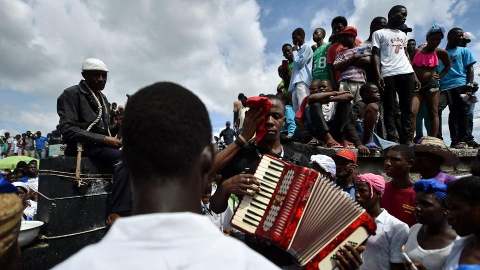 Voodoo followers take part in Day of the Dead celebrations in the Cemetery of Cite Soleil, in Port-au-Prince. Voodoo is practiced in Haiti and by its diaspora, with roots in West African religions that underwent syncretism with local traditions and Christianity under colonial rule as a means of preserving culture. (Hector Retamal / AFP)