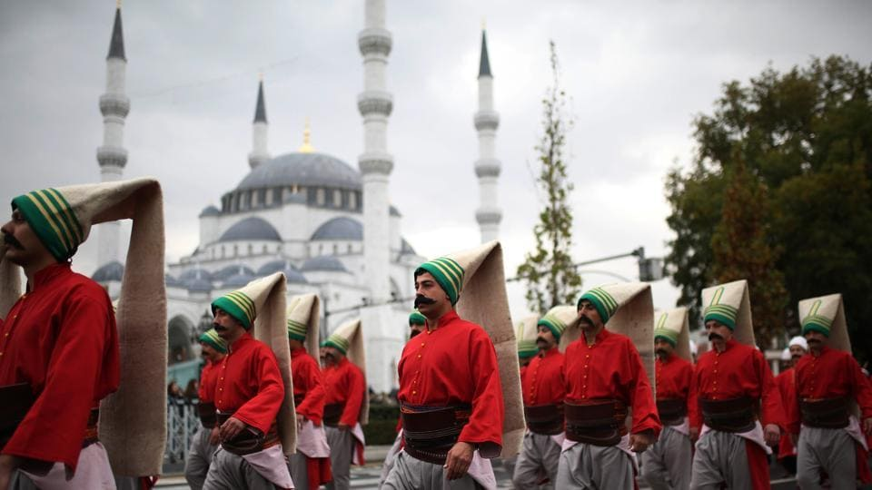 Turkish soldiers dressed as Janissaries (Yeniceri) from the Ottoman era, march during the 94th Republic Day parade, from the Grand National Assembly of Turkey to the first Turkish Grand National Assembly building, in the Ulus district of Turkey. (Adem Altan / AFP)