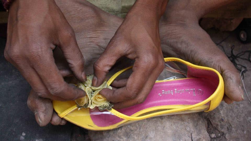 Surinder mends shoes in central Delhi.