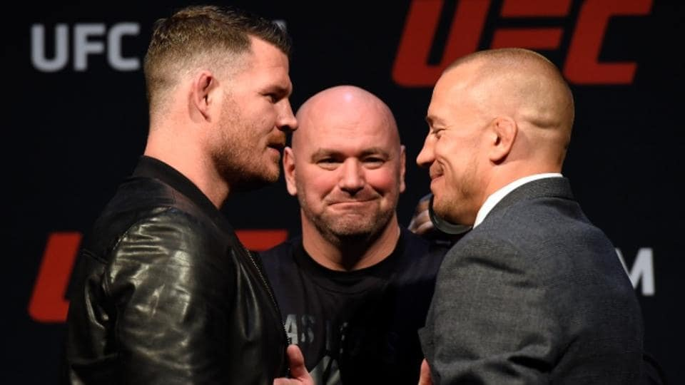 Georges St. Pierre (R) face Michael Bisping in his comeback fight at UFC 217.