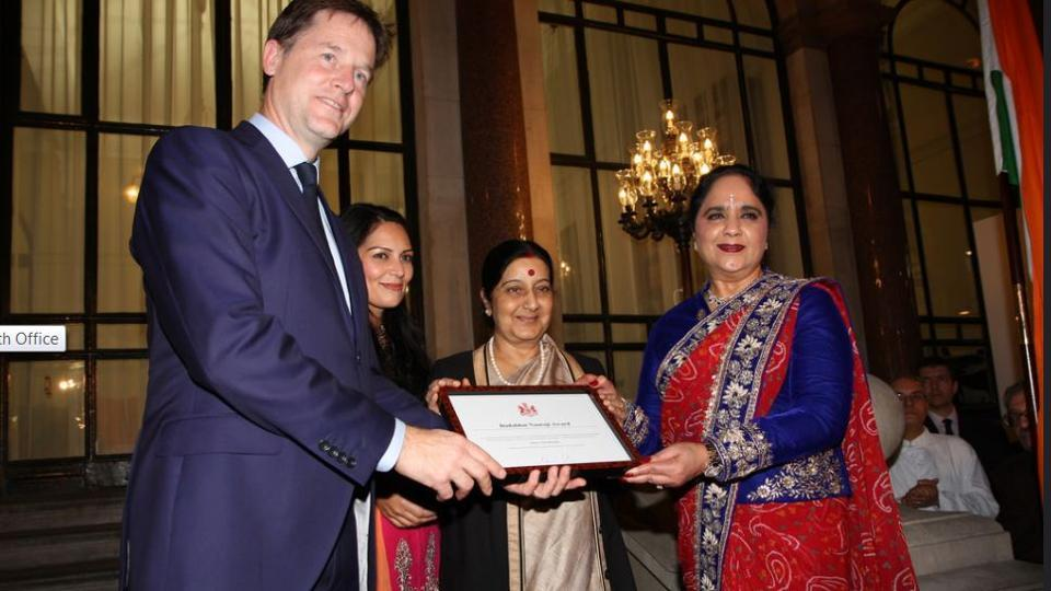 Former deputy prime minister Nick Clegg (Left) presents a Dadabhai Naoroji Award along with Priti Patel (second from left) and external affairs minister Sushma Swaraj on October 17, 2014.