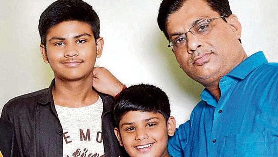 The victims Imi Lal with his sons Manav and Kalash. Their relative also died in the accident .