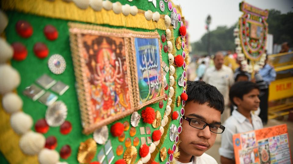 A boy carries a decorated pankha during the Phool Walon ki Sair in New Delhi. The Sair began as fulfilment of Queen Mumtaz Mahal Begum's vow to walk to the shrine of Hazrat Qutubuddin Bakhtiyar Kaki in Mehrauli for the return of her son Mirza Jahangir from exile, who shot at the British Resident Sir Archibald Seton on his disapproval of the emperor's choice of Jahangir as heir apparent over Bahadur Shah Zafar II. (Sanchit Khanna / HT Photo)