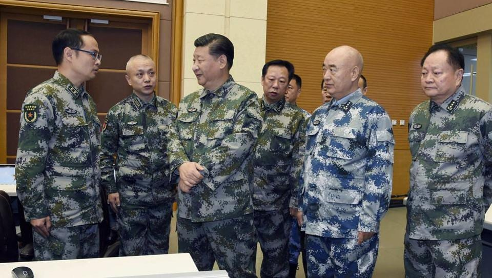 In this November 3, 2017 photo released by China's Xinhua news agency, President Xi Jinping (centre) visits the Central Military Commission (joint battle command centre in Beijing as part of an inspection tour.
