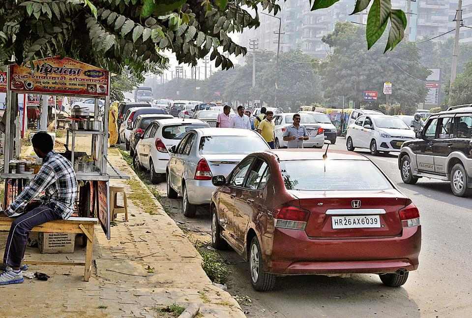 Parking on the road near the Artemis hospital leaves commuters with no space.