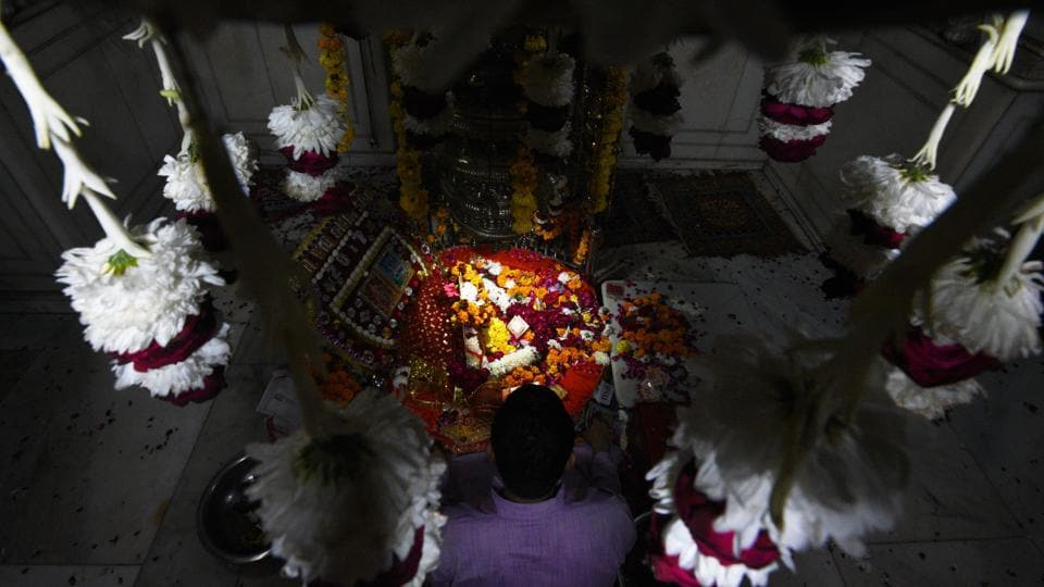 Offerings are laid during Phool Walon ki Sair at Yogmaya Temple in New Delhi. The procession, traditionally held in the month of Bhado'n (August/September) is now held after the monsoon. It forms a way of offering obeisance and asking for a fruitful year at two places of worship belonging to two communities among flower traders. (Sanchit Khanna / HT Photo)