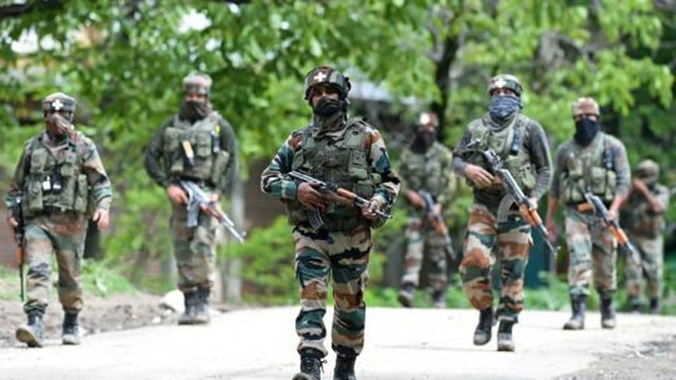 Army soldiers conduct a patrol during an operation against suspected rebels in Turkwangam Lassipora in Shopian on May 4.