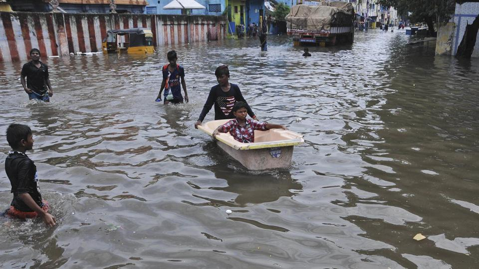 People resort to a bathtub as makeshift boat in a waterlogged street in Chennai, on November 3, 2017. With the northeast monsoon active in the state and neighbouring Puducherry, nearly 74% of the rainfall expected during the entire season was recorded in the first week, the state meteorological department said. (AP)