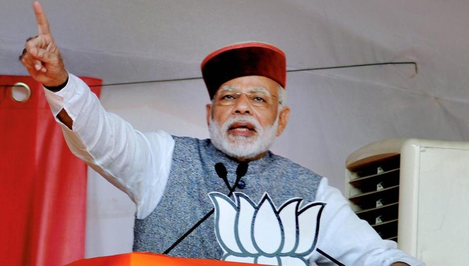 Prime Minister Narendra Modi waves at crowd during BJP Parivartan Rally at Rait near Dharamsala on Saturday.