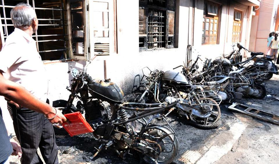The remains of the eight vehicles in Sadashiv peth, near Tilak road after they were set on fire at midnight.