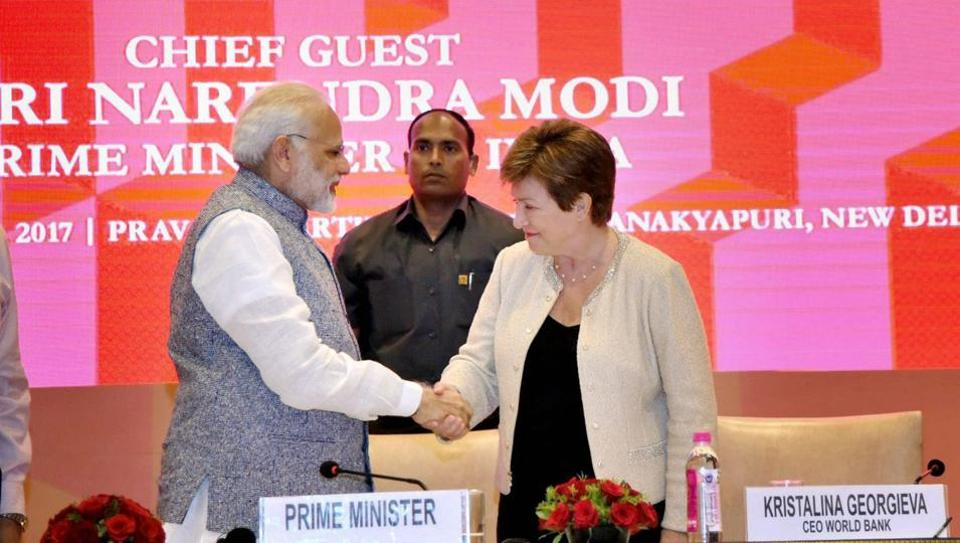 Prime Minister Narendra Modi shakes hands World Bank CEO Kristalina Georgieva at a session on India's Business Reforms, at the Pravasi Bhartiya Kendra in New Delhi on Saturday.