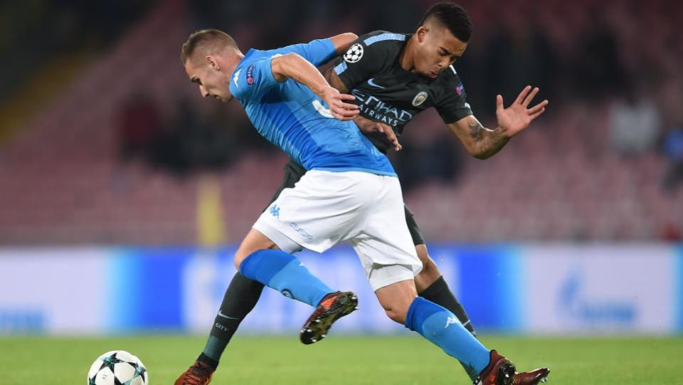 Napoli's midfielder Marko Rog (L) vie with Manchester City's Brazilian striker Gabriel Jesus during Union of European Football Associations organised UEFA Champions League football match played between Napoli vs Manchester City at the San Paolo stadium in Naples. (Filippo Monteforte / AFP)