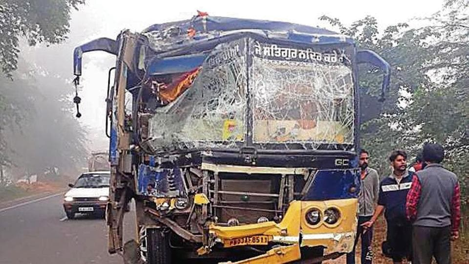 Mangled remains of a bus near Rode village in Moga.