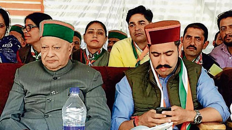 CM Virbhadra Singh with his son Vikramaditya Singh in Shimla (rural) assembly segment on Saturday.