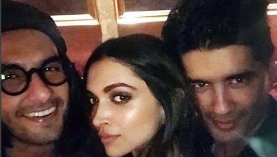 Ranveer Singh and Deepika Padukone pose with Manish Malhotra at a bash to celebrate Padmavati trailer's success.