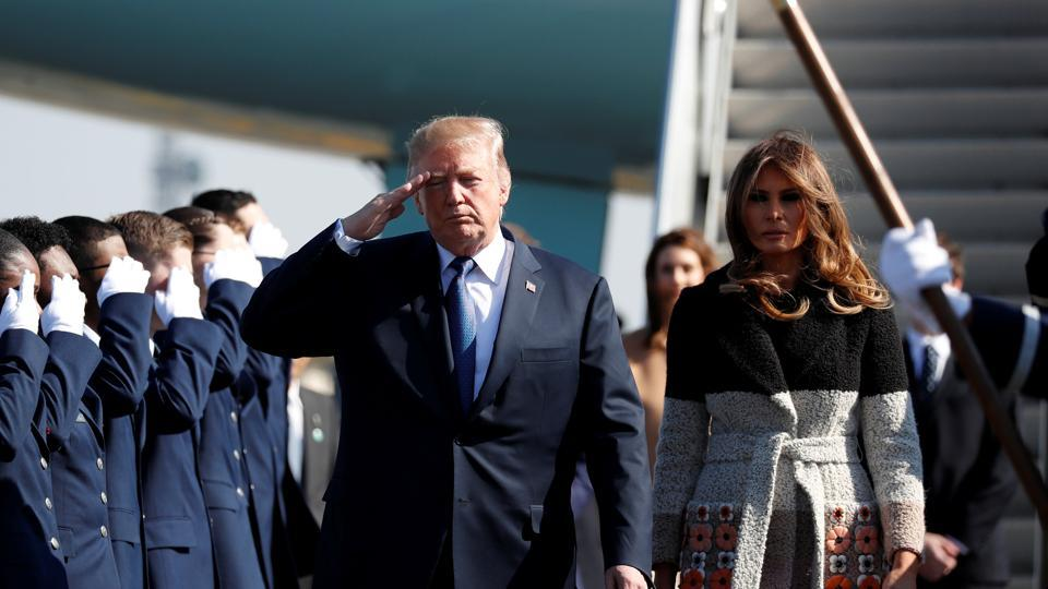 US President Donald Trump and first lady Melania Trump arrive on Air Force One at US Air Force Yokota base in Fussa, on the outskirts of Tokyo, Japan, on Sunday.