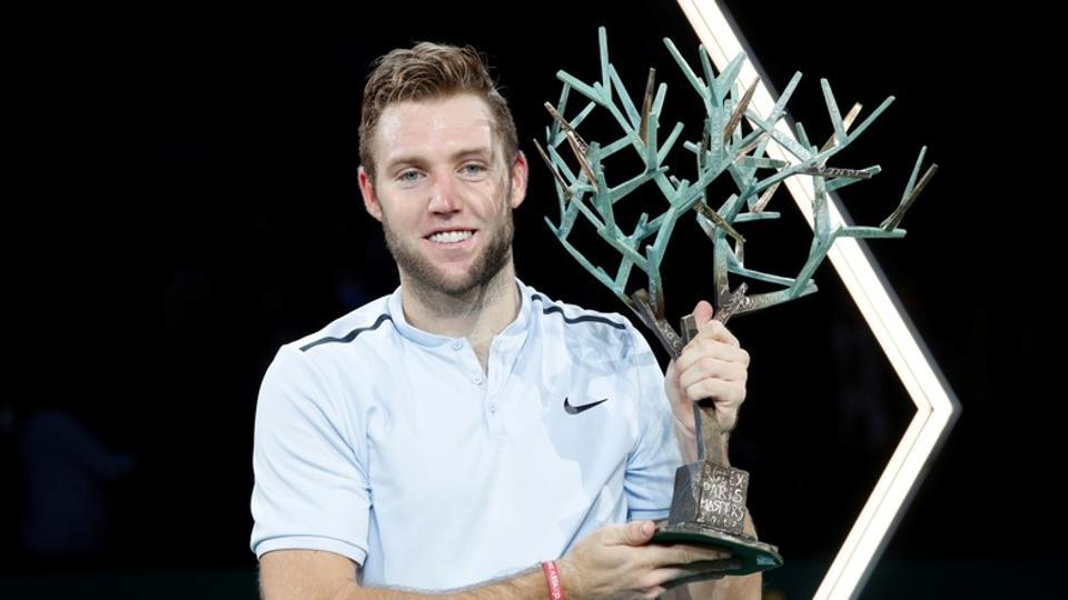 Jack Sock celebrates after winning with the Paris Masters  title.