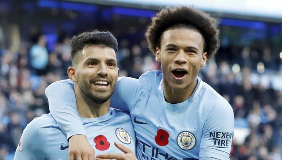 Sergio Aguero, left, celebrates scoring his Manchester City's second goal against Arsenal in Premier League.
