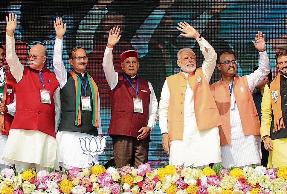 PM Modi with BJP's CM face Prem Kumar Dhumal and other party leaders in Una on Sunday.