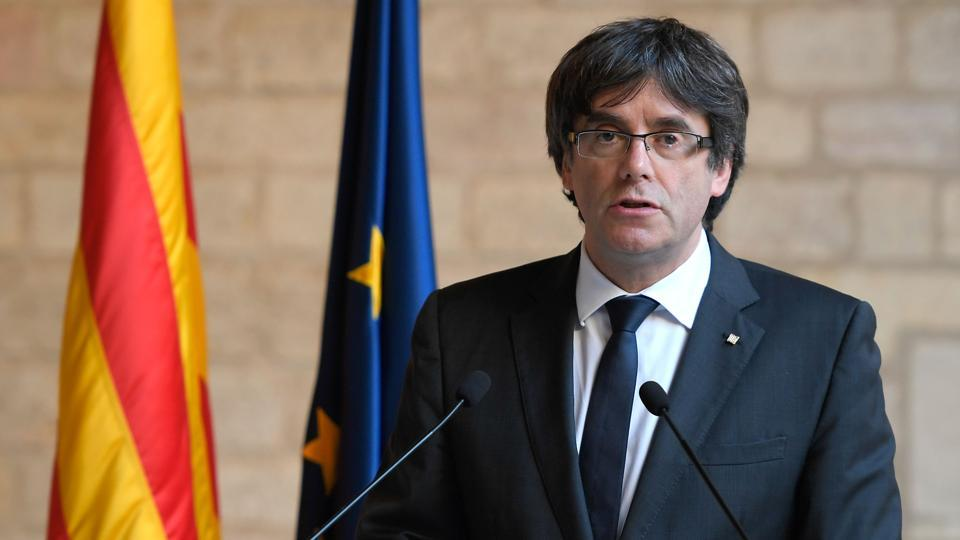 Sacked Catalan President Carles Puigdemont making a statement at the Generalitat (Catalan government headquarters) in Barcelona.