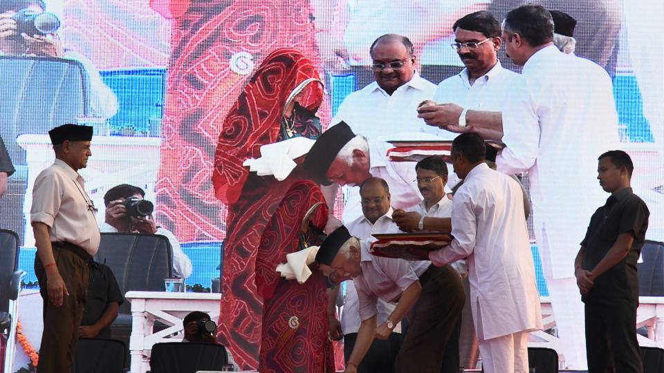 RSS chief Mohan Bhagwat felicitates a martyr 's mother  at Swar Govindam programme at Chitrakoot Stadium in Jaipur on Sunday.