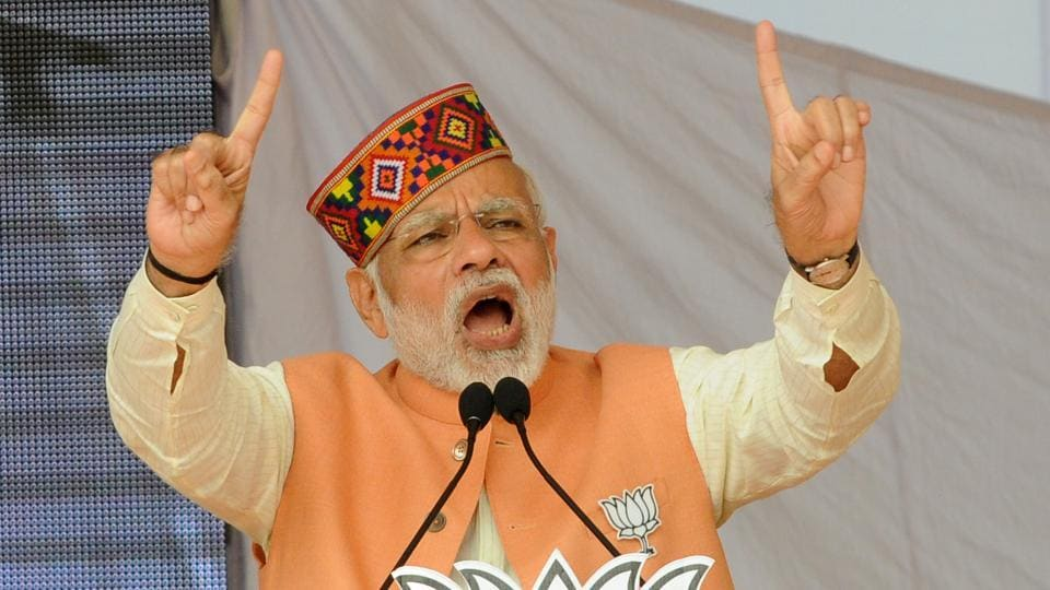 PMNarendra Modi speaks during an election rally ahead of assembly elections at Una district in Himachal Pradesh.
