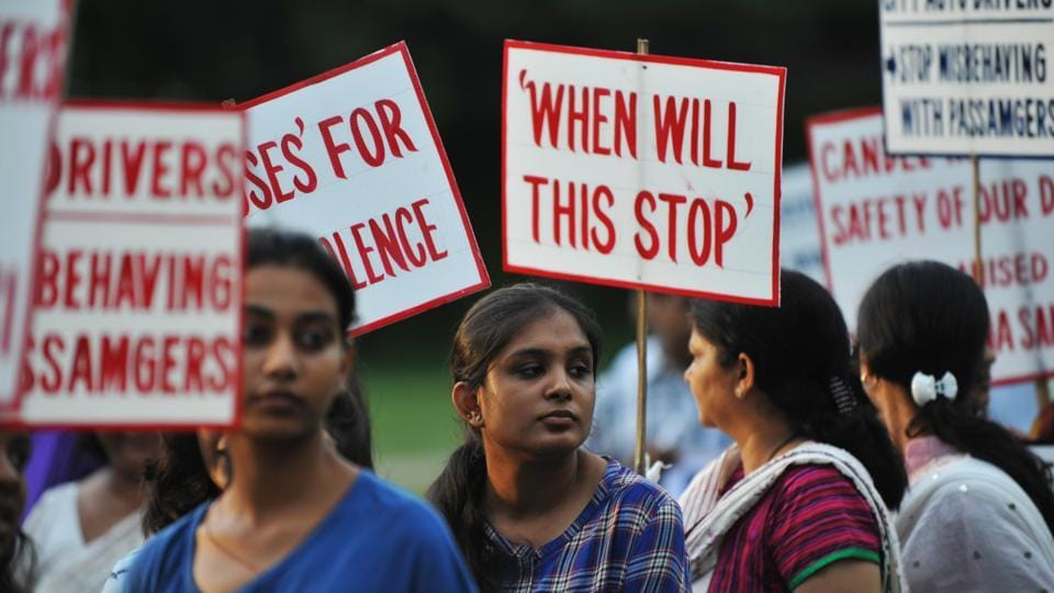 Activists holds placards as they protest against violence and crimes against women in Siliguri.