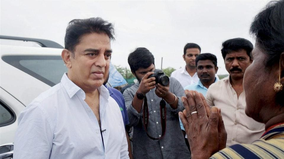 Actor Kamal Haasan meets fishermen in the Ennore area of Chennai.