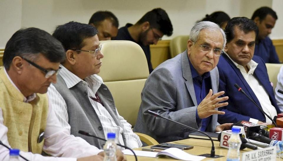 Niti Aayog vice chairman Rajiv Kumar, flanked by his team members V K Saraswat (second left) and the Aayog CEO Amitabh Kant, addresses a press conference in New Delhi.