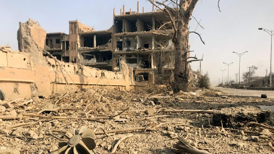 A picture shows the damage in the eastern Syrian city of Deir Ezzor during a military operation by government forces against Islamic State on November 4.