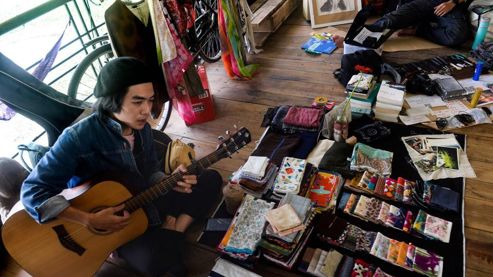 A man strums a guitar at a once-a-month ex lover's (Old Flames) market in Hanoi.
