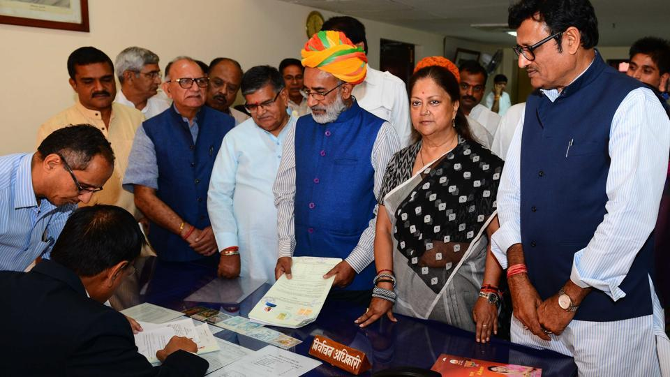 Union minister Alphons Kannanthanam  (wearing turban) files nomination papers.