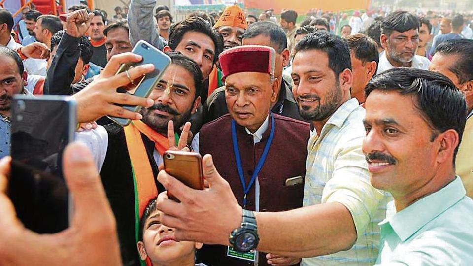 Prem Kumar Dhumal during an election rally in Una on Sunday.