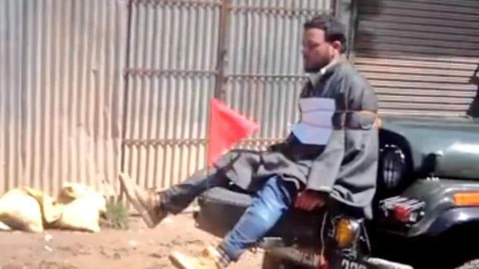 A screengrab of a video showing Farooq Ahmed Dar tied to a jeep as a 'human shield' against protesters.The video had triggered outrage in Kashmir.