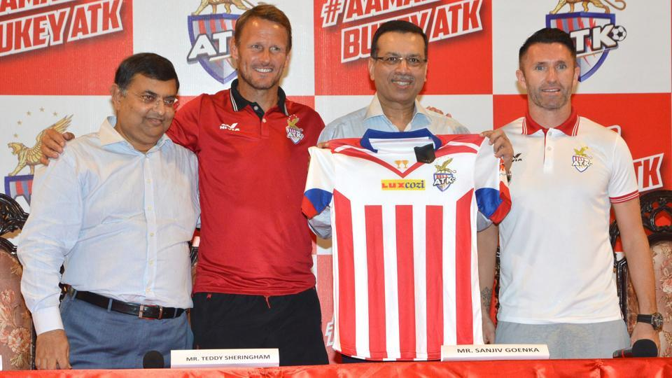 ATK coach Teddy Sheringham (second from left) and skipper Robbie Keane (right) unveil the team shirt with owners Utsav Parekh (left) and Sanjiv Goenka in Kolkata on Monday.