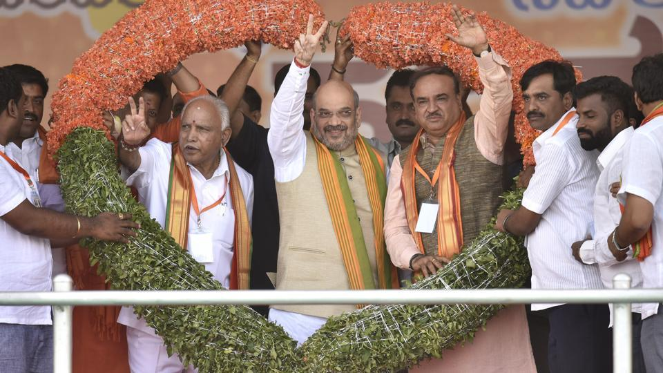 BJP national president Amit Shah (centre) with the party's state unit president and chief minister candidate Yeddurappa (left) and Union minister Ananth Kumar during the inauguration of party's Parivartan Yatra in Bengaluru, on November 2, 2017.