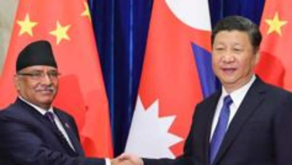 File photo of Chinese President Xi Jinping (right) shaking hands with former Nepalese prime minister Pushpa Kamal Dahal at the Great Hall of the People in Beijing on March 27, 2017.