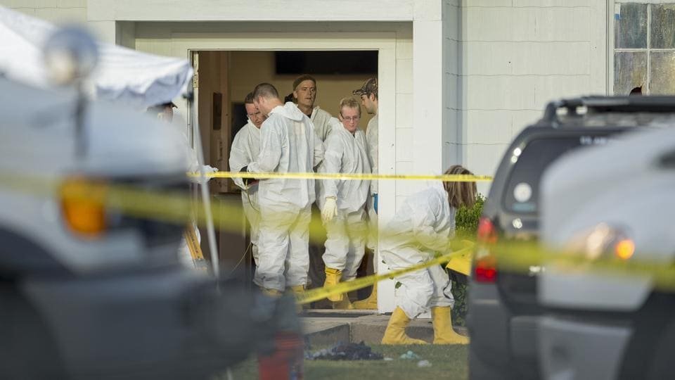 Forensic investigators work at the scene of the shooting at the First Baptist on November 5, 2017. The victims ranged in age from 5 to 72 years old, law enforcement officials told a news conference. Among the dead was the 14-year-old daughter of Pastor Frank Pomeroy, the family told several television stations. (Jay Janner / Austin American-Statesman via AP)