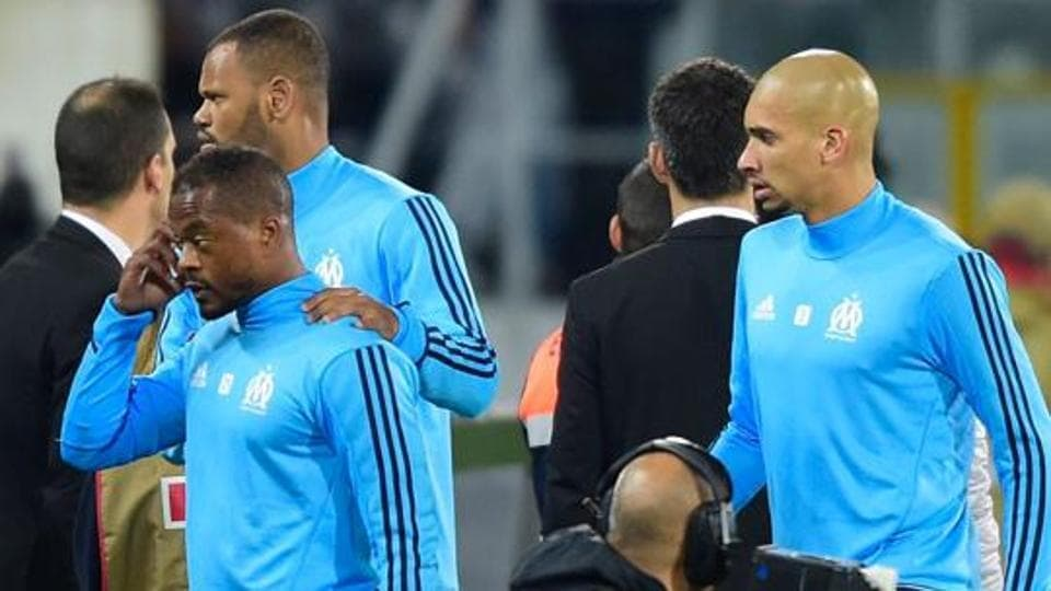 Patrice Evra has been suspended by UEFAafter he launched a karate kick at one of Marseille's own supporters in a Europa League game.